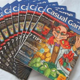 A stack of the first issue of Casual Game Insider